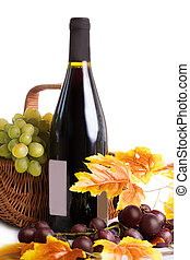 Bottle of wine with grapes in basket