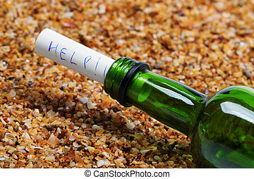 Bottle of wine with help message on sand in beach at sun summer day