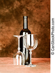bottle of wine with two glasses
