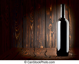 Bottle on a wooden background
