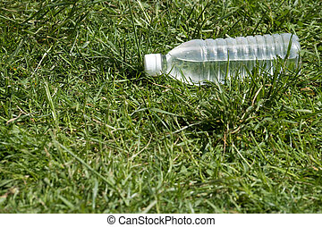 Bottle water and grass
