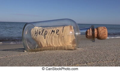 bottle with a message on ocean beac