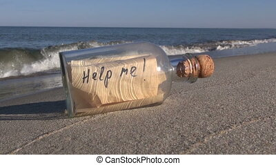 Bottle with a message on the beach