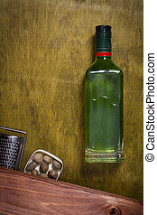 Bottle with absinthe on a wooden background