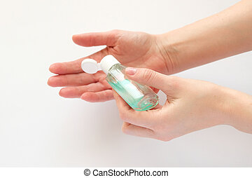 Bottle with antibacterial antiseptic gel in hand on white. Hand hygiene, sanitizer. Pandemic Covid-19