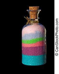 Bottle with bath salt on black background