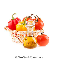bottle with olive oil on the background of the wattled dish with tomatoes and pepper on a white background