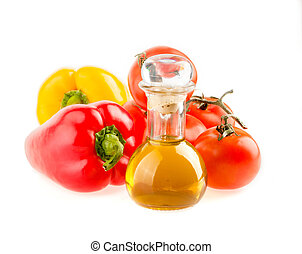 bottle with olive oil ,tomatoes and peppers on a white background
