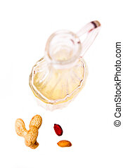 Bottle with peanut oil on white background view from above