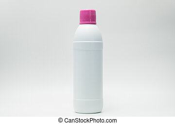 Bottle with pink cap isolated on white background