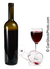 bottle with red wine and glass