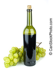 Bottle with red wine and green grapes near