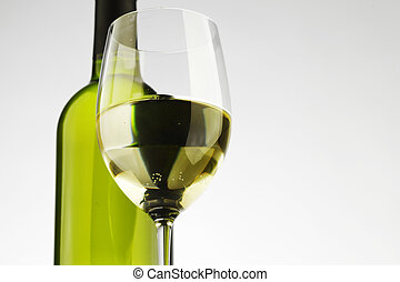 bottle with white wine and glass