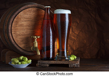 Bottled and unbottled beer glass with barrel