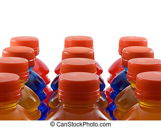 Photo of orange, blue, and red bottled drinks isolated on white