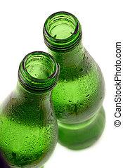 bottled water in green, condensation-covered bottles;...