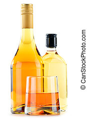 Bottles and glasses of alcoholic beverages isolated on white