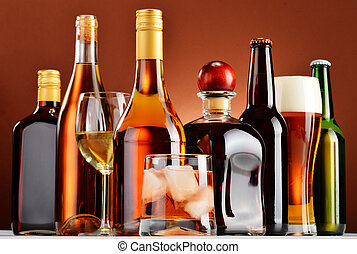 Bottles and glasses of assorted alcoholic beverages.