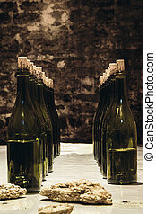 Bottles are on the table - Bottles stand on a table in an...