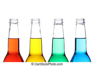 bottles with red, yellow, green, and blue liquids, close up isolated on white