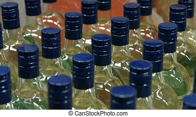 Bottles of alcoholic drink close-up - The goods are on a...