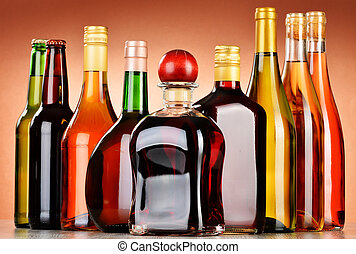 Bottles of assorted alcoholic beverages including beer and ...