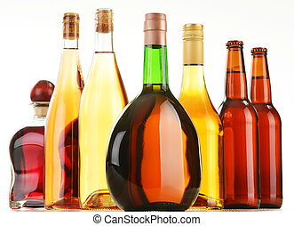 Bottles of assorted alcoholic beverages isolated on white ...