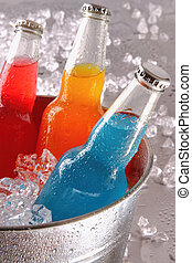 Bottles of cool drinks in ice bucket steel counter