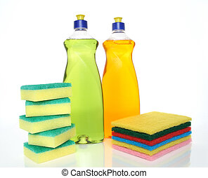 Bottles of dishwashing liquid and sponges - Cleaning...