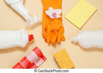 Bottles of dishwashing liquid, rubber gloves and sponges on ...