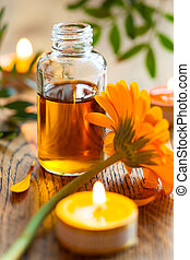 essential oil, candles and flowers - bottles of essential ...