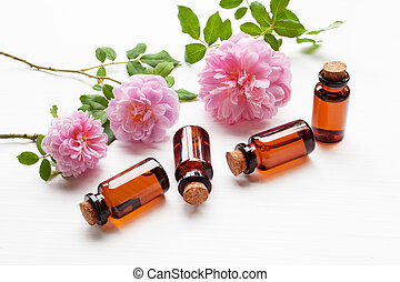 Bottles of essential rose oil for aromatherapy, Huntington Rose.