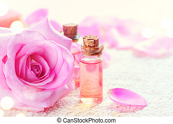Bottles of essential rose oil for aromatherapy. Rose spa concept