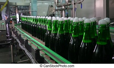 Bottles of green color move along conveyor - Bottles of...
