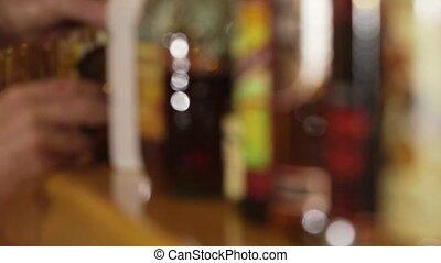 Bottles of liquor at a bar - Bottles on liquor, spirits,...