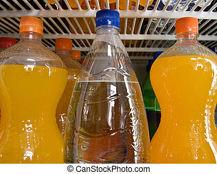 Bottles of mineral and sweet water in a refrigerator