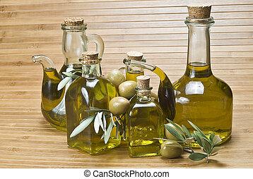 Bottles of olive oil and olives 5.
