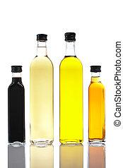 Bottles of olive oil and vinegar - Several bottles of olive ...