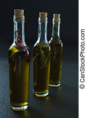 Bottles of olive oil with herbs