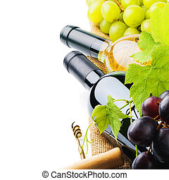 Bottles of red and white wine with fresh grape isolated over white