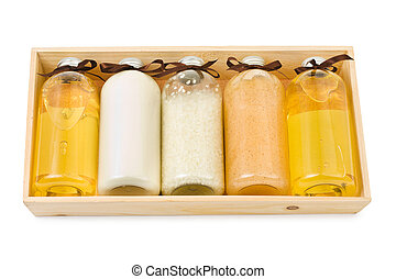 Bottles of spa oil and salt in box isolated on white background