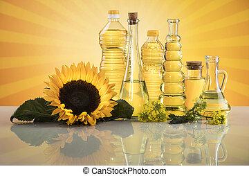Bottles of sunflower oil with flower