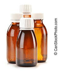 Bottles of syrup medication on white background