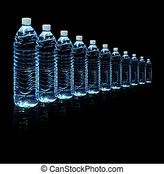 Bottles of water isolated on black background