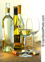 Bottles of white wine with glasses ready for wine tasting