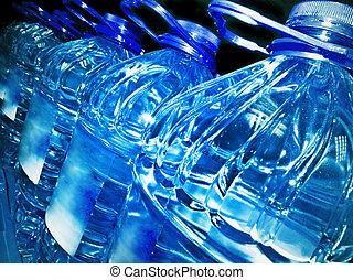 bottles - row of the bottled water in dark