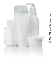 bottles tubes pads and towel for skincare