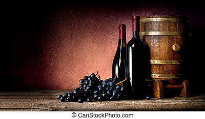 Bottles with cask and grape - Bottles of wine with cask and...