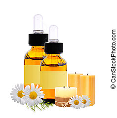 bottles with essence oil, candles and chamomiles isolated on...