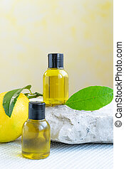 Bottles with essential lemon oil. Healthy natural beauty treatment